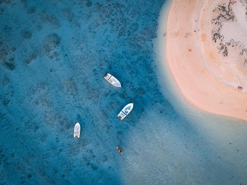 Boats at a beach in Mauritius